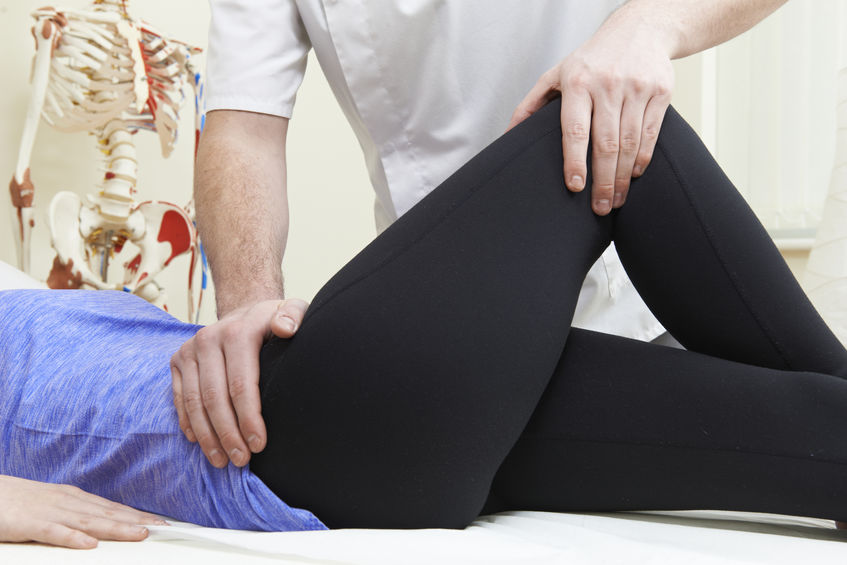 doctor treating hip issue
